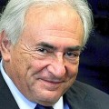 File photo of former IMF chief Strauss-Kahn smiling during his arraignment hearing at New York Supreme Court in New York